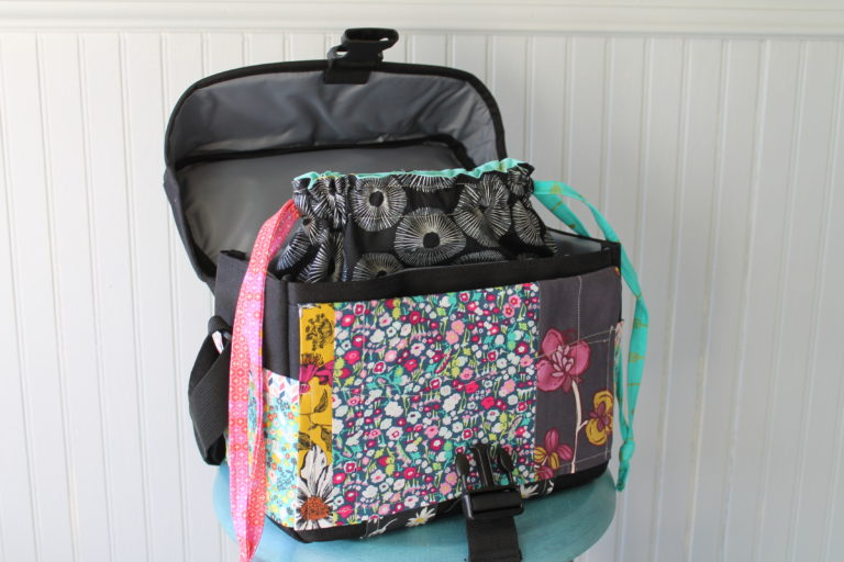 Add color and function to your standard issue black camera bag