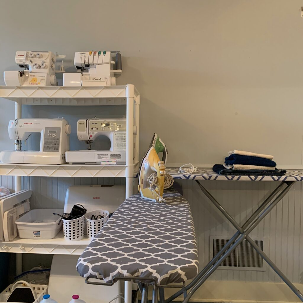 Sewing machine and ironing station